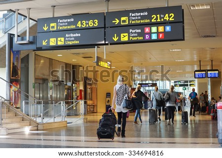 VALENCIA, SPAIN - OCTOBER 12, 2015: Airline Passengers inside the Valencia Airport. About 4.98 million passengers passed through the Valencia, Spain airport in 2014. - stock photo