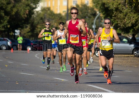 VALENCIA, SPAIN - OCTOBER 21: Runners compete in the XXI Valencia Half Marathon on October 21, 2012 in Valencia, Spain. - stock photo