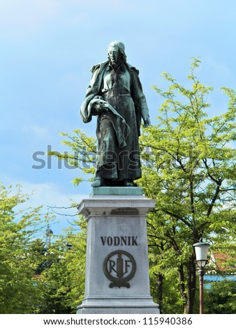 Valentin Vodnik (1758-1819) was a Carniolan priest, journalist and poet of Slovene descent. His bronze statue is the work of the sculptor Alojz Gangl. It stands in the  center of Vodnik Square. - stock photo