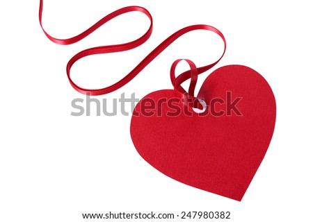 Valentine card or heart shaped gift tag with red ribbon isolated on a white background.  Space for copy.  - stock photo