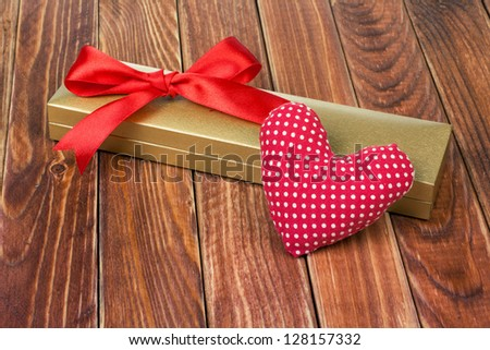 Valentine card with heart and gift box
