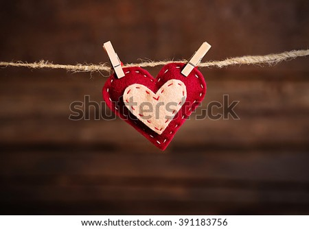 Valentine concept. Love heart hanging on clothesline - stock photo
