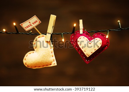 Valentine concept. Two love hearts hanging on clothesline - stock photo