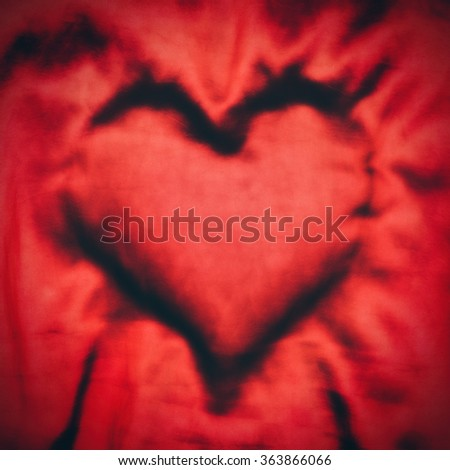 Valentine concept with red heart shape in textile, soft focus effect - stock photo