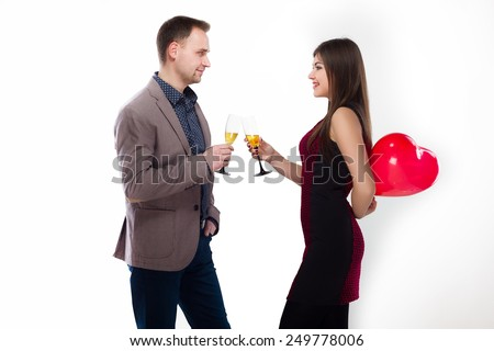 Valentine Couple. Portrait of Smiling Beauty Girl and her Handsome Boyfriend Happy Joyful Family. Love Concept. Heart Sign. Happy Lovers. Valentines Day - stock photo