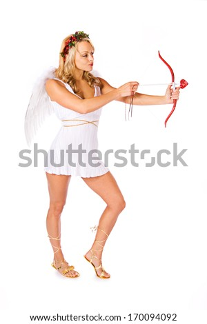 Valentine Cupid: Shooting bow and arrow. - stock photo