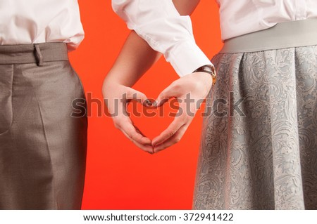 Valentine day background, happy couple holding hands together - stock photo