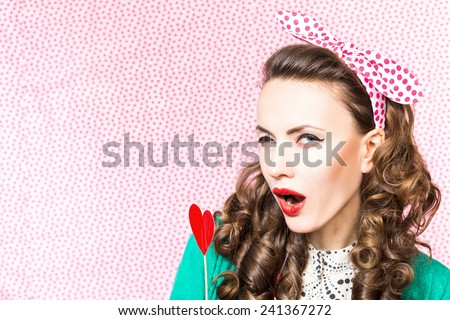 Valentine day. Beautiful woman holding red hearts  smiling. studio shot - stock photo