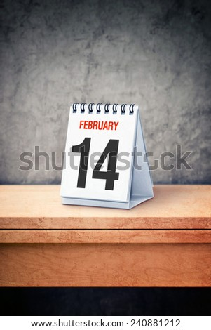 Valentine day concept. February 14th on desk calendar at office table. Reminder of upcoming holiday. - stock photo