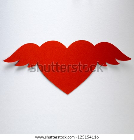 Valentine day heart with angel wings paper-craft greeting card - stock photo