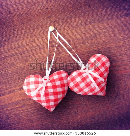 Valentine day love beautiful. Heart handmade mark hanging on rope on wooden background. - stock photo