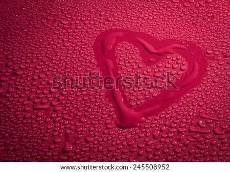 Valentine Day Love heart made by water bubbles on a red background - stock photo