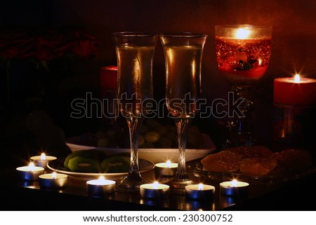 valentine day of champagne and candle. Romantic evening - stock photo