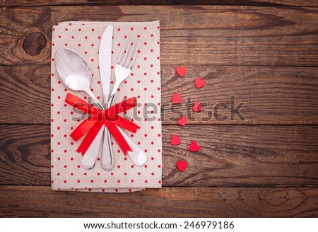 Valentine dinner. Knife and fork on the plate close-up. Valentine's day table setting concept.  - stock photo