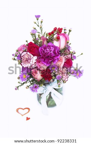 Valentine Fresh Flower Bouquet in a Glass Jar - stock photo