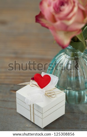 Valentine gift decorated with heart - stock photo
