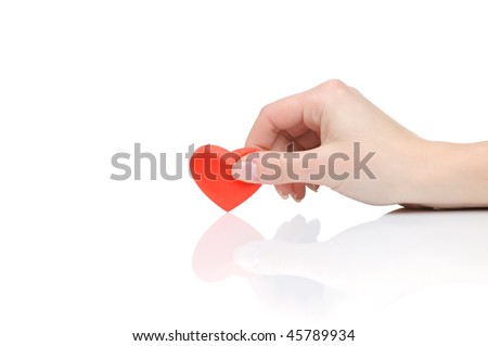 Valentine heart in a female hand isolated on white background - stock photo