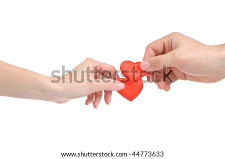 Valentine heart in male and female hands isolated on white background - stock photo