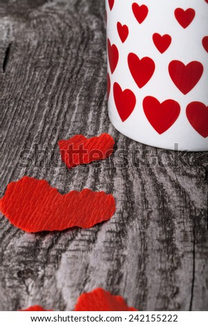 Valentine hearts and cup of tea on the old wooden table. - stock photo