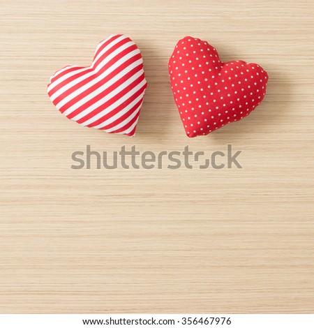 Valentine hearts on wooden background - stock photo
