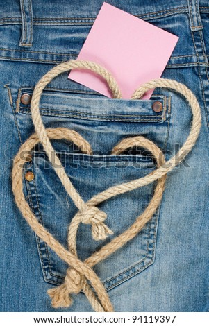 Valentine hearts shaped of rope, paper card on denim jeans background - stock photo