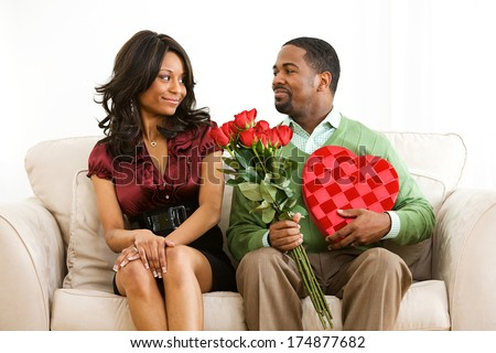 Valentine: Man Has Romantic Gifts For Woman - stock photo