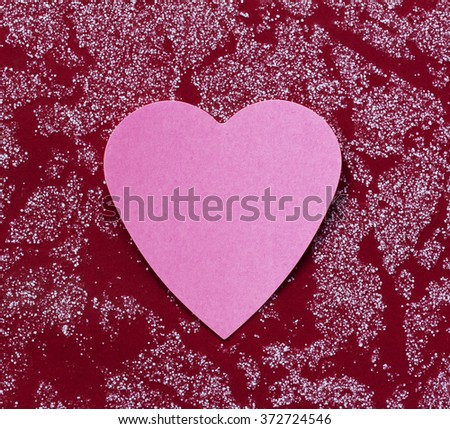 Valentine - paper pink heart against a red surface. Copy space. Free space for text, Close-up, top view - stock photo