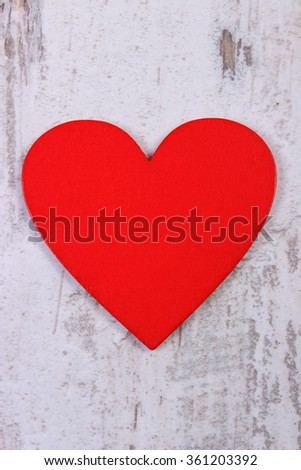 Valentine red heart on old wooden white table, symbol of love, concept of valentines day
