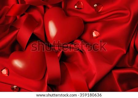 Valentine red heart on red silk background. Valentine's Day - stock photo