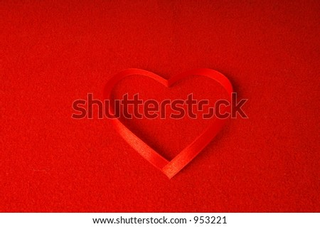 valentine - red ribbon on a red texture - stock photo