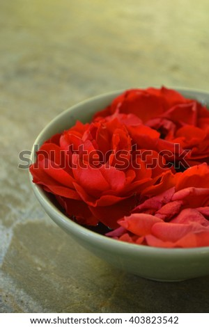 Valentine red rose green  ceramic on stone background, close up macro - stock photo