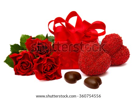 Valentine's composition with roses, chocolaty candy, gift box and heart on white background