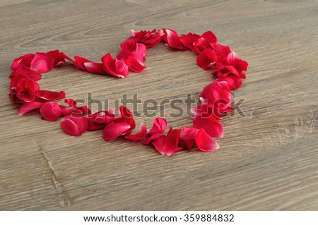 Valentine's Day. A heart made out of red rose petals