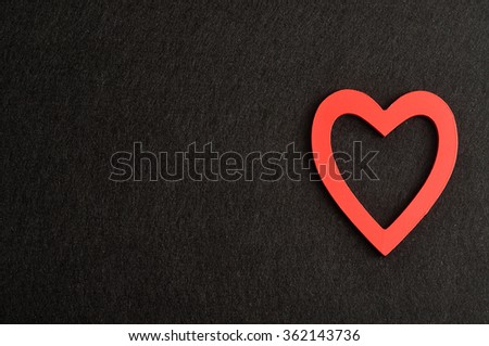 Valentine's Day. A red heart isolated against a black background