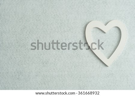 Valentine's Day. A white wooden heart isolated against a white background