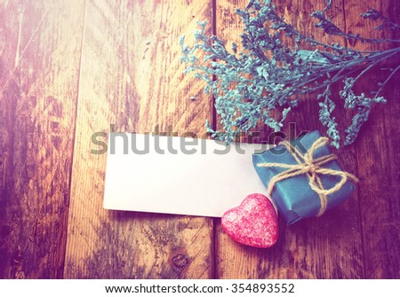 Valentine's day background, simple little gift, heart, decorative branch, paper tag - stock photo