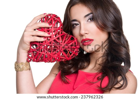 Valentine's Day. Beautiful blond woman with heart in his hands. Young man with red heart on white background - stock photo