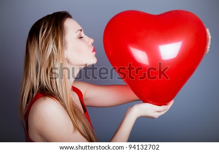 Valentine's Day. Beautiful woman with heart in his hands - stock photo