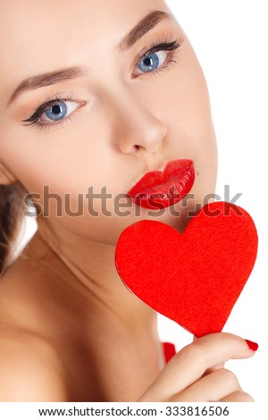 Valentine's Day. Beautiful young woman with heart in her hands. Young woman with red heart on white background. portrait of attractive smiling woman isolated on white studio shot with hearts. close up - stock photo