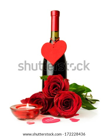 Valentine's Day. Bottle of wine , red roses and candle isolated on white