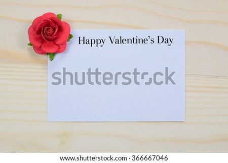 Valentine's day card on wooden table. - stock photo
