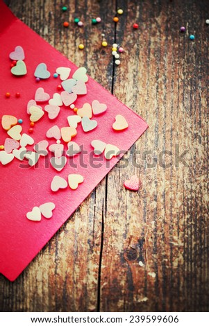 Valentine's day card with heart on wooden background / romantic love background