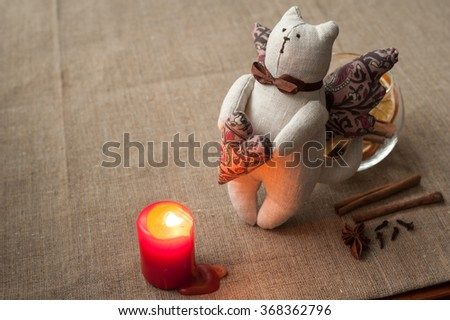 Valentine's Day. Composition: cat toy, bowl with spices and lit candle. February 14. - stock photo