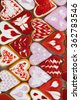 Valentine's day cookies. Heart shaped cookies for valentine's day.Red and Pink Heart Shaped Cookies. Valentine`s Day background. Romantic seamless pattern with cookies hearts. - stock photo