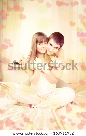 Valentine's Day, cosy couple relaxing in bedroom  - stock photo
