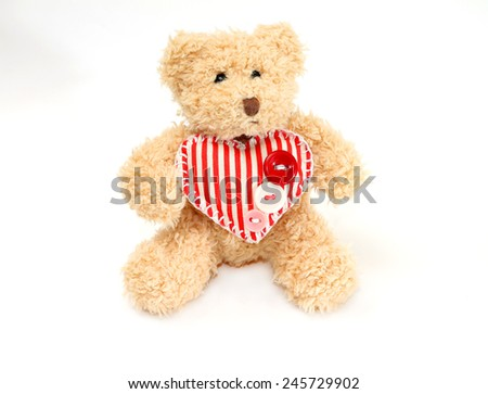 Valentine's Day. Cute teddy bear with heart, isolated on white - stock photo