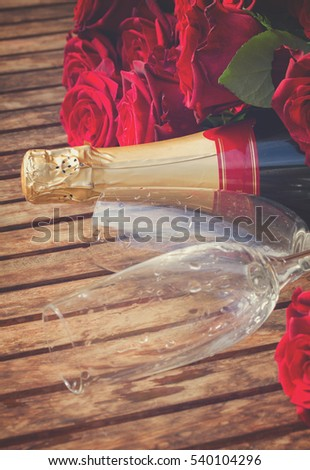 Valentine's day dark red roses, two glasses and neck of champagne wine, retro toned