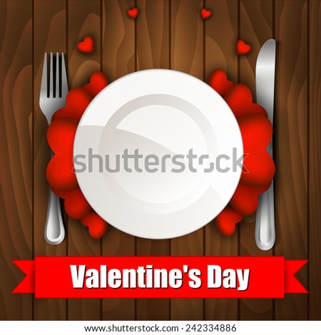 Valentine's day dinner with table setting on wooden table