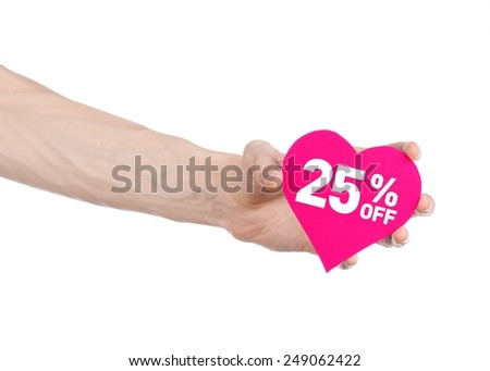 Valentine's Day discounts topic: Hand holding a card in the form of a pink heart with a discount of 25% on an isolated white background in studio - stock photo