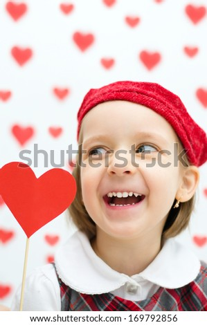 Valentine's Day - dreaming cute child holding red hearts